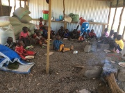 Children eating in temporary dining hall